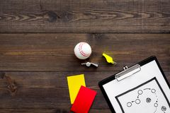 Sport judging concept. Baseball referee. Tactic plan for game, base-ball ball, red and yellow cards, whistle on wooden. Background top view Royalty Free Stock Images