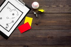 Sport judging concept. Baseball referee. Tactic plan for game, base-ball ball, red and yellow cards, whistle on wooden. Background top view Royalty Free Stock Photo