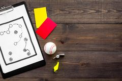Sport judging concept. Baseball referee. Tactic plan for game, base-ball ball, red and yellow cards, whistle on wooden. Background top view Stock Image