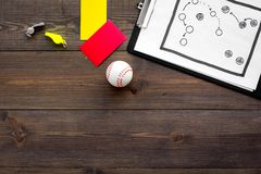 Sport judging concept. Baseball referee. Tactic plan for game, base-ball ball, red and yellow cards, whistle on wooden. Background top view Stock Photography