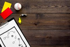 Sport judging concept. Baseball referee. Tactic plan for game, base-ball ball, red and yellow cards, whistle on wooden. Background top view Royalty Free Stock Image