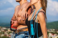 Sport, jump rope, fitness, couple sports. Sportive woman and man, team. Sporty couple showing muscle and workout royalty free stock photography