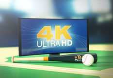 Sport on 4k format. Curved tv with 4k on screen, a baseball ball and bat, on a baseball field (3d render Royalty Free Stock Photography