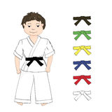 Sport karate boy and colored belts Royalty Free Stock Photography