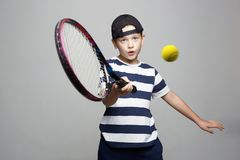 Sport kid. Child with tennis racquet and ball. Little Boy Playing Tennis. Sport kid. Child with tennis racquet and ball royalty free stock photos