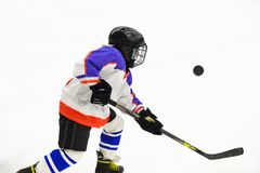 Kids ice hockey. Sport for Kids. Young ice hockey player royalty free stock photos