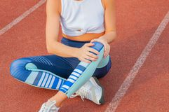 Sport knee injury. Woman has pain in knee after run outdoors royalty free stock photos