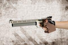 Sport laser pistol, pentathlon weapons. gun in female hands. Sport laser pistol, pentathlon weapons. gun in female gloved hands stock photo