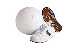 Sport leather shoes and ball. Isolated, clipping path included royalty free stock photo