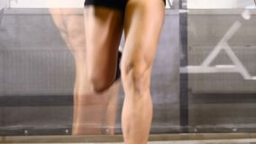 Sport in life. Attractive 20s. Female legs and feet on the treadmill in gym club. Wellbeing concept. walking track. Cross fit stock video footage