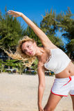 Sport and lifestyle concept - woman doing sports outdoors.  Royalty Free Stock Photography