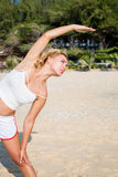 Sport and lifestyle concept - woman doing sports outdoors Royalty Free Stock Photo