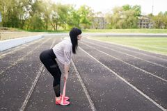 Sport and lifestyle concept - woman doing sports outdoors stock image