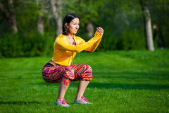 Sport and lifestyle concept - woman doing sports Royalty Free Stock Photos