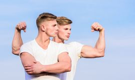 Sport lifestyle and healthy body. Attractive twins. Handsome strong twins. Men twins muscular brothers sky background. Men strong muscular athlete bodybuilder royalty free stock images