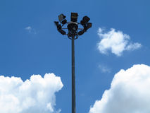 Sport lights with cloudy sky. Stock Photography