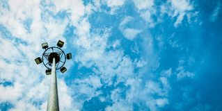 Sport lights of the stadium with pole on beautiful blue sky royalty free stock photos