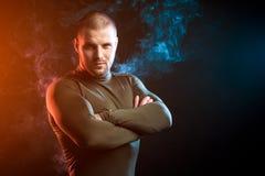 Sport man against vape cloud royalty free stock photo