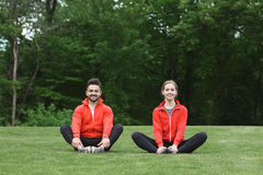 Sport Man And Woman Meditating In Park Stock Photography