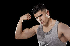 Sport man with big and strong athletic body posing with arm bent showing bicep muscle chest and shoulders Royalty Free Stock Images