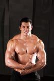 Sport man body studio on dark. stock image