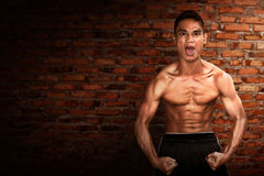 Sport man. On brick wall background Royalty Free Stock Photos