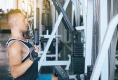 Sport man doing exercises training,Cross fit body and muscular in the gym royalty free stock photos