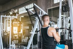 Sport man doing exercises training,Cross fit body and muscular in the gym royalty free stock photo