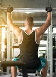 Sport man doing exercises training,Cross fit body and muscular in the gym stock photo