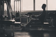 Sport men doing exercises training,Cross fit body and muscular in the gym,Black and white toned royalty free stock photo