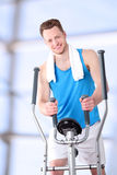 Sport man doing healthy Fitness with a Exercise Machine Royalty Free Stock Images