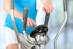Sport man doing healthy Fitness with a Exercise Machine Royalty Free Stock Image