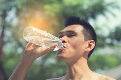 Sport man drinking a bottle of water Stock Photos