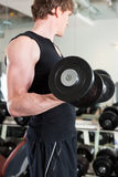 Sport - man is exercising with barbell in gym Stock Photo