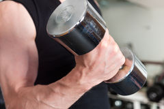 Sport - man is exercising with barbell in gym Royalty Free Stock Images