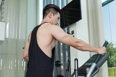 Sport man is exercising on treadmill machine Royalty Free Stock Photography
