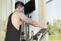 Sport man is exercising on treadmill machine Royalty Free Stock Photos