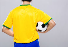 Sport man hold football Stock Images