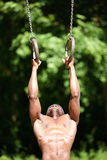 Sport man holding gymnast rings Royalty Free Stock Photography