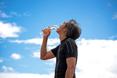 Sport man holding a water bottle after exercise, royalty free stock images