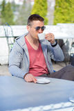 Sport man, hot cup of coffee. Coffee lover concept. Stock Image