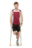 Sport man injured fitness on crutches Royalty Free Stock Photography