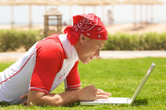 Sport man & laptop Royalty Free Stock Images