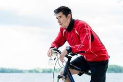 Sport man on mountain bike resting Royalty Free Stock Image