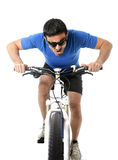 Sport man riding bike training hard on sprint in fitness and competition Royalty Free Stock Image
