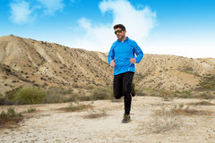 Sport man running on dry desert landscape in fitness healthy lifestyle Stock Photos