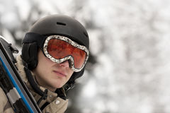 Sport man with ski. Portrait of a snowboarder wearing a helmet and glasses on the snow background Stock Photography
