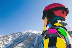 Sport man in snowy mountains. An image with a portrait of a snowboarder wearing a helmet and glasses on the background of high snow-capped Alps in Grindelwald Royalty Free Stock Images