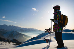 Sport man in snowy mountains at sunset Royalty Free Stock Image