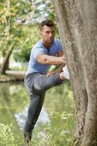 Sport man stretching at park. Sport man stretching at the park Stock Photo